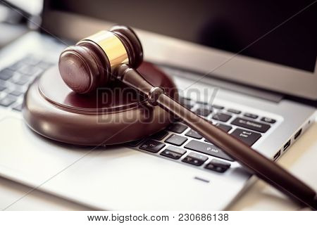 Gavel on laptop computer keyboard concept for online internet auction or legal attorney assistance