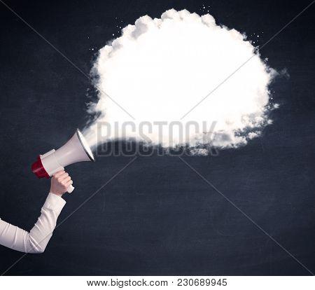Caucasian business hand holding megaphone with white plain message cloud