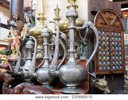 Display Of An Antique Shop. Antique Market In Dubai. Ancient Arabic Vessels For Sale.