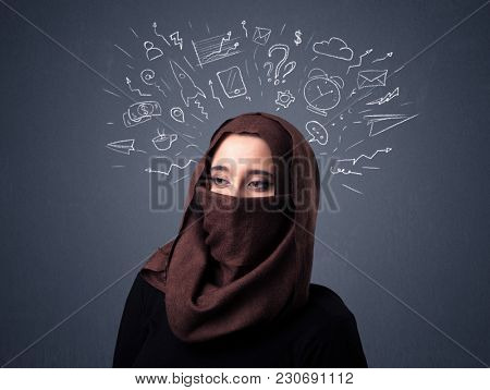 Young muslim woman wearing niqab with mixed white drawings above her head