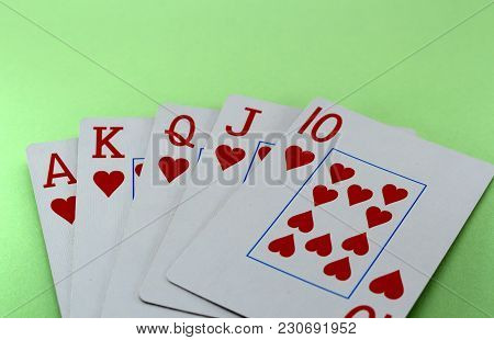 Win In Poker! Royal Flush Of A Heart On A Green Background Close-up