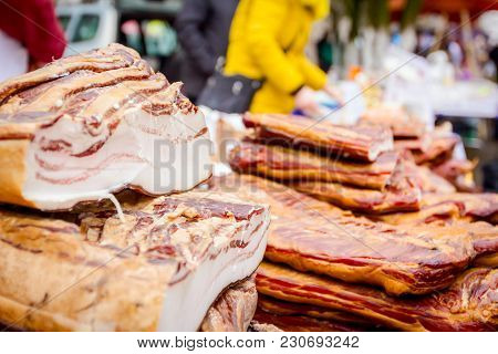 Bunch Of Cured Bacon, Meat For Sale At Outdoor Flea Market.