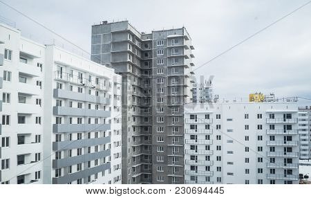 High-rise Buildings Under Construction With Windows And Balconies