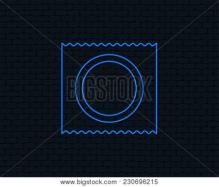 Neon Light. Condom In Package Safe Sex Sign Icon. Safe Love Symbol. Glowing Graphic Design. Brick Wa