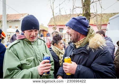Belo Blato, Vojvodina, Serbia - February 10, 2018: Two Happy Buddies Are Holding Cans Of Different B
