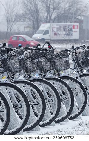 Kolobrzeg, West Pomeranian / Poland - 2018: City Bikes In The Dock Are Waiting For Users