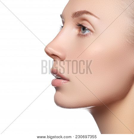 Beauty Makeup. Skin Care Face. Attractive Girl On White Background. Beautiful Face Of Young Woman. S