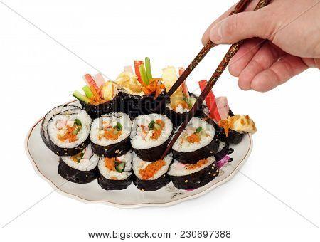 Korean food, gimbap, chopsticks. White background.
