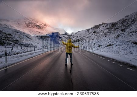 Explorer Walking On A Street In The Middle Of Snowy Landscape