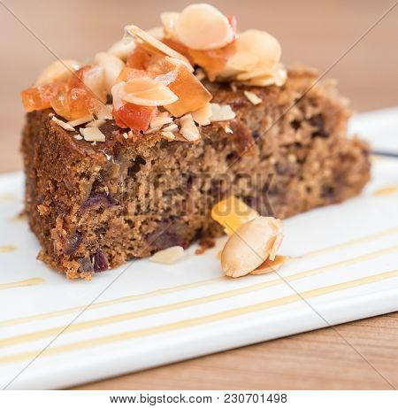 Carrot cake dessert pastry bread with fruit topping