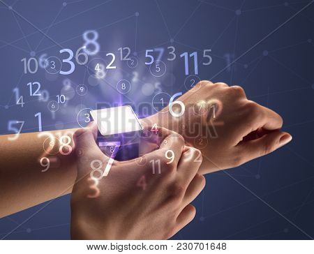 Close up female naked hand wearing smartwatch and numbers around