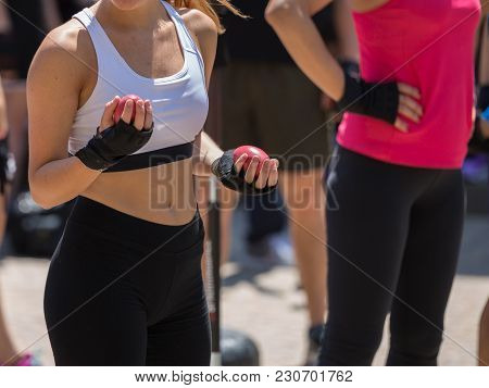 Fitness And Exercising Concept: Girls Workout With Speed Ball And Free Standing Boxing Punch Bag.