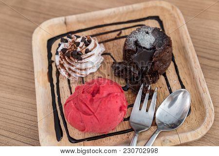 chocolate lava cake with ice cream and chocolate sauce