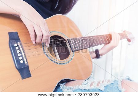 Playing The Guitar. Guitar Lessons. Acoustic Guitar. Relax While Playing The Guitar In Room.