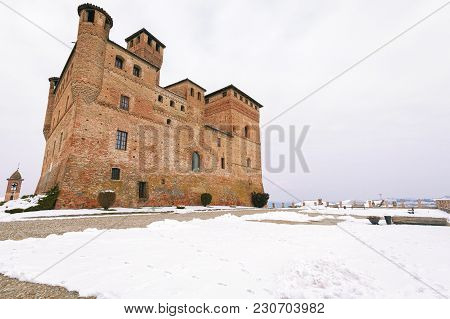 Grinzane Cavour Cuneo, Italy - February 28, 2018: Winter Wide View Of The Grinzane Castle From Its C