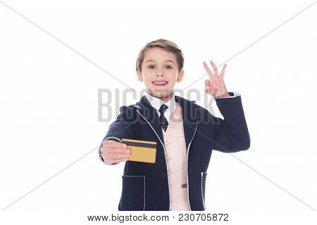 Little Boy Holding Golden Credit Card And Ok Sign, Isolated On White