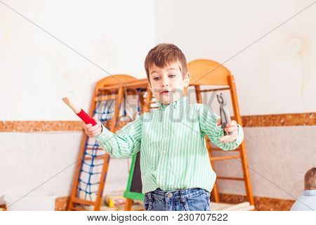 The Boy Is Imaginate He Is Builder. Imagination Game In The Kindergarten