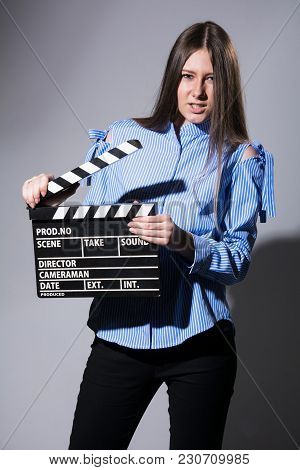 Young Woman With A Movie Cracker