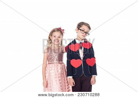 Smiling Little Girl Embracing Upset Boy Tied With Rope And Red Hearts Isolated On White