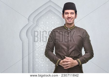 Smiling Asian Muslim Man With Cap And Traditional Dress