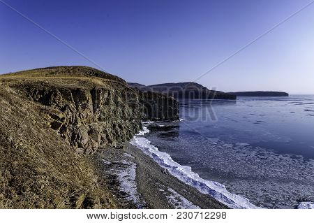 Rocky Coastline Of Russian Island In Winter Season