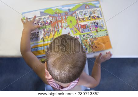 Cute 2 Years Boy Discovering Pop-up Book Stories. Overhead Shot