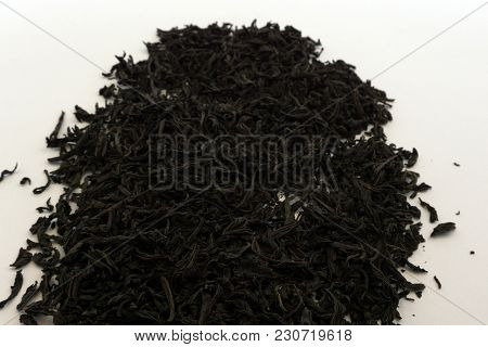 Dry Tea Leaves Are Scattered On The Table. Indian Tea With Pieces Of Fruit And Dried Flowers. Tea Ti