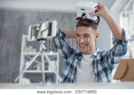 I Love Gadgets. Good-looking Exuberant T Smart Well-built Teenager Putting On A 3d Model And Smiling