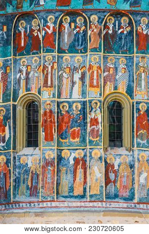 Voronet, Romania, July 06, 2015: Orthodox Church Exterior With Painted Murals, Painted Church In Rom