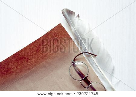 Literature Concept. Quill Pen Near Old Blank Paper On White Wooden Background