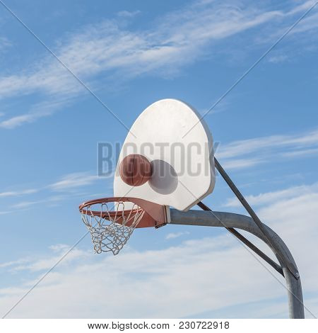 Close-up Basketball Hoop Rim And Backboard Under Cloud Blue Sky