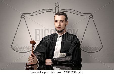 Young handsome judge in black gown making decision