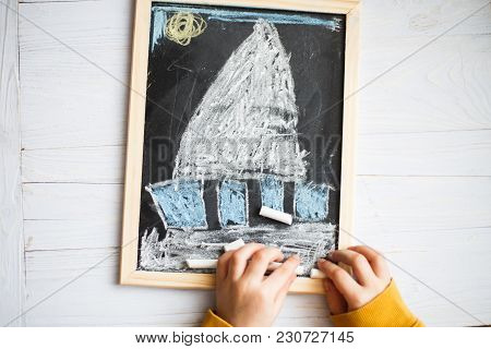 Children's Drawing On The Slate. Children's Drawing Crayons