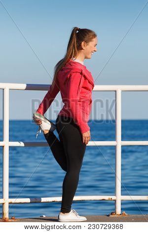 Woman Doing Sports Outdoors. Fitness Girl In Sportswear On Seaside Exercising Keep Her Body Muscles