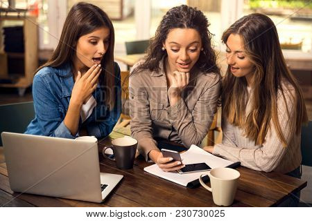 Group of girls making a pause on the studies for some gossip
