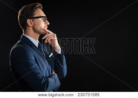 I Need To Think. Thoughtful Bespectacled Unshaken Man Spending Time In The Spacious Room Looking Asi