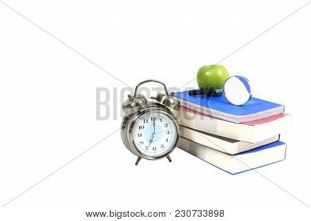 Books , Green Apple , Magnifying Glass And Traditional Wind-up (keywound) , Spring-driven Alarm Cloc