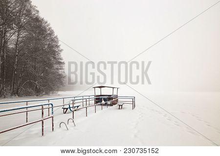 Belarus, Grodno, Molochnoe Lake. Summerhouse On The Beach In Winter.