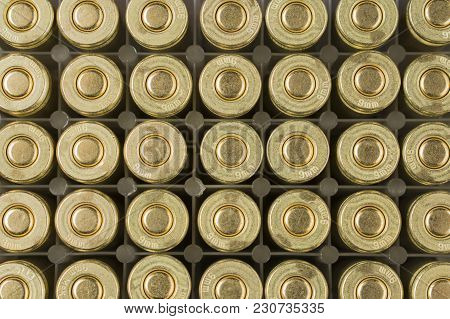 Background Of Cartridges Of 9 Mm Caliber In Even Rows