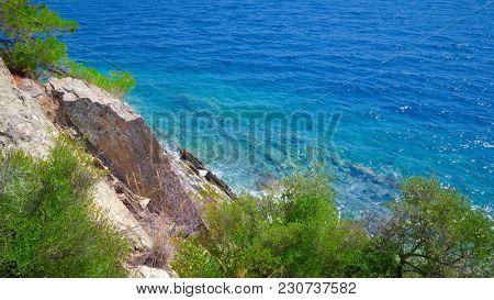 Blue sea shore under clear sky