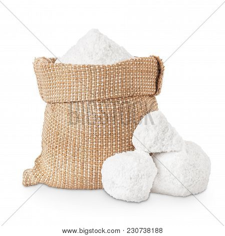 Pieces Of Salt And Crystals Of Salt In Bag Isolated On White Background