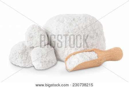 Lumps Of Salt And Scoop Isolated On White Background