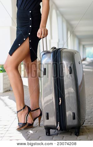 Sexy women with luggage