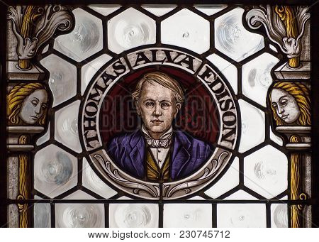 Munich, Germany - November 17, 2017: Portrait Of Inventor Thomas Alva Edison On Stained-glass Window