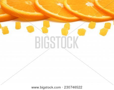 Fresh Orange Slice And Small Pieces On White Background, With Copy Or Free Space For Text.