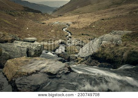 Nature, Rural Winter  Landscape With Running Water Brook Winding Through Rocks, Hills And Valley