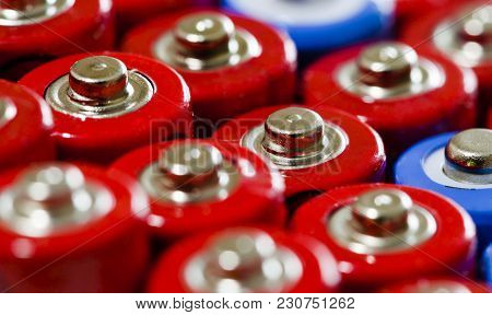 Several Aa Batteries Shot Top Down In Two Colors