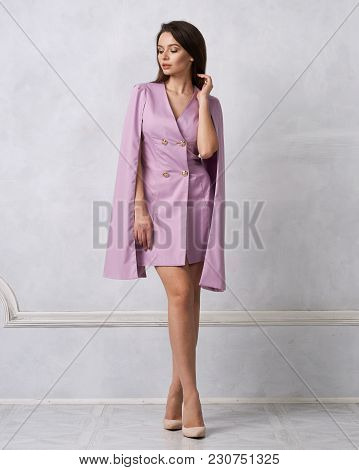 Attractive Brunette Female Model Wearing Mini Purple Dress With Golden Buttons, Split, Long Hanging