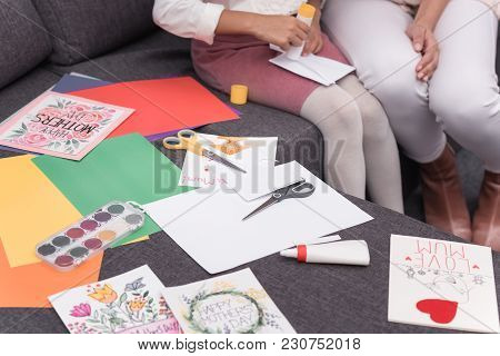 Cropped Image Of African American Mother Helping Daughter Making Greeting Cards On Mothers Day