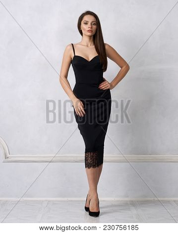 Beautiful Female Model With Long Brunette Hair Demonstrating Black Bodycon Dress With Straps And Lac